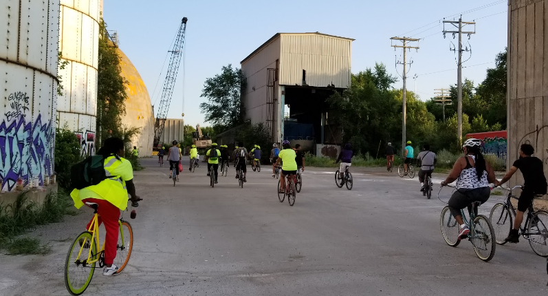 Black people & people of color biking at the Upper Harbor Terminal site in North Minneapolis