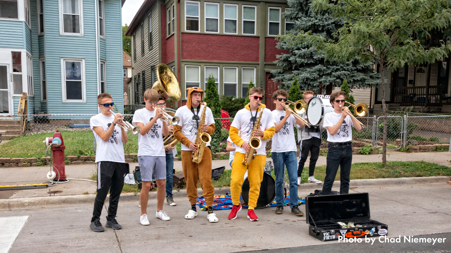 People playing in a brass band at Open Streets Nicollet