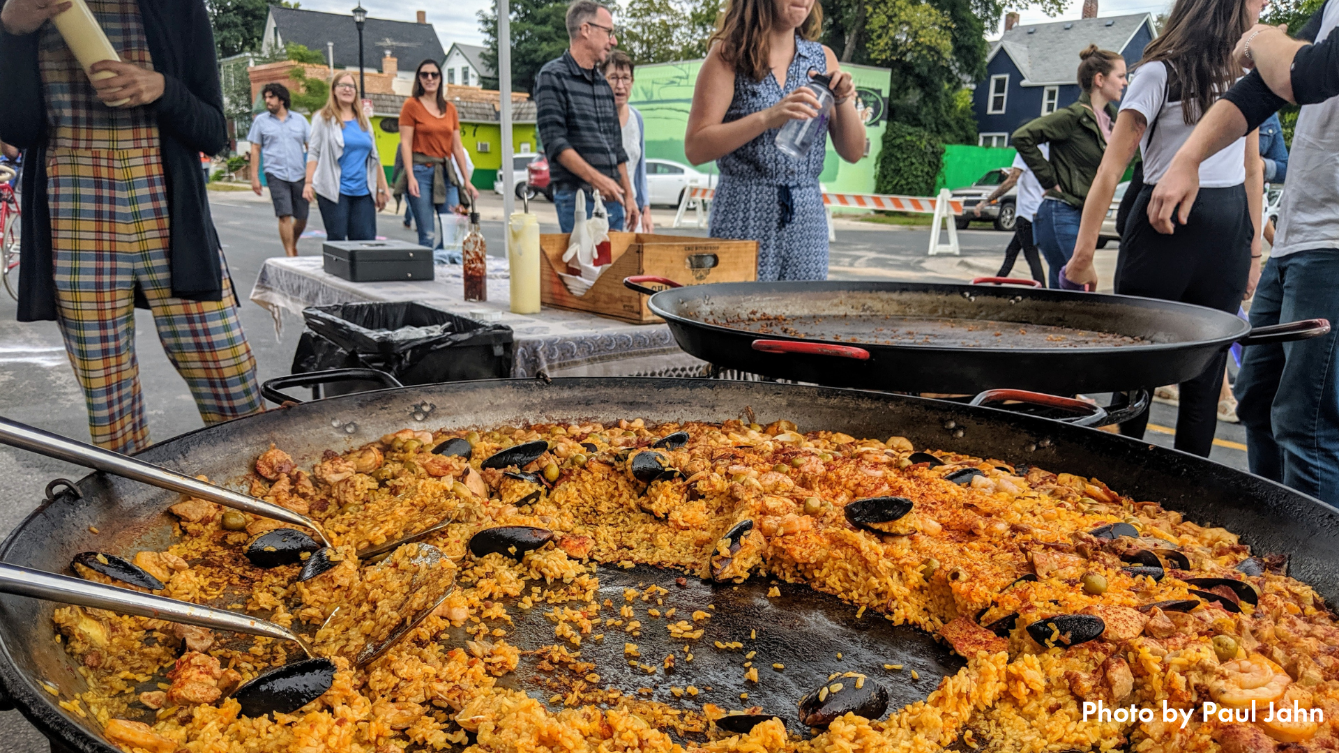 Food cooking in a  large pan at Open Streets Nicollet