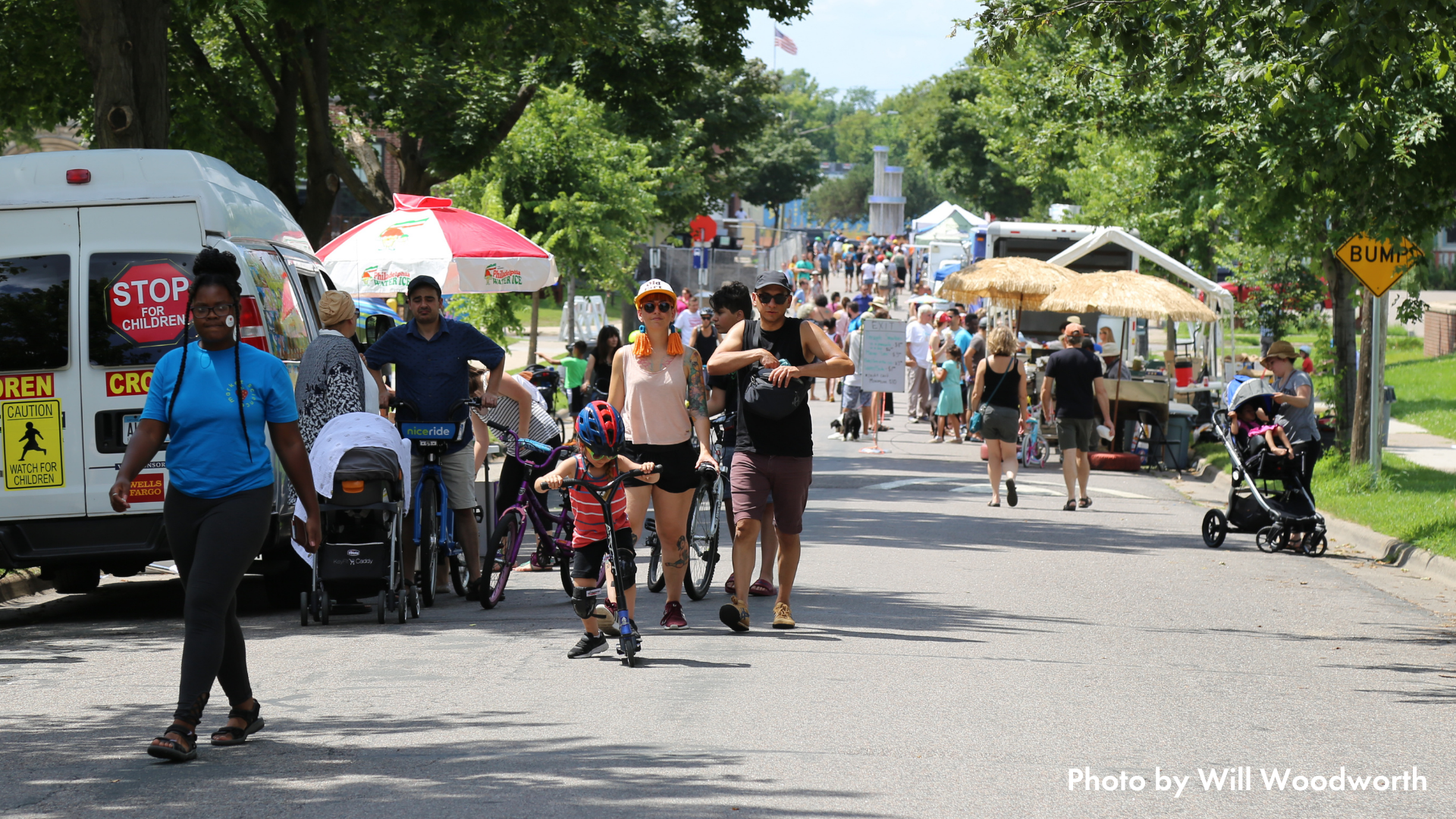 People walking on a tree-lined street at Open Streets Northeast 2019