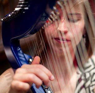 amelia_romano_looking_through_harp300sq.jpeg