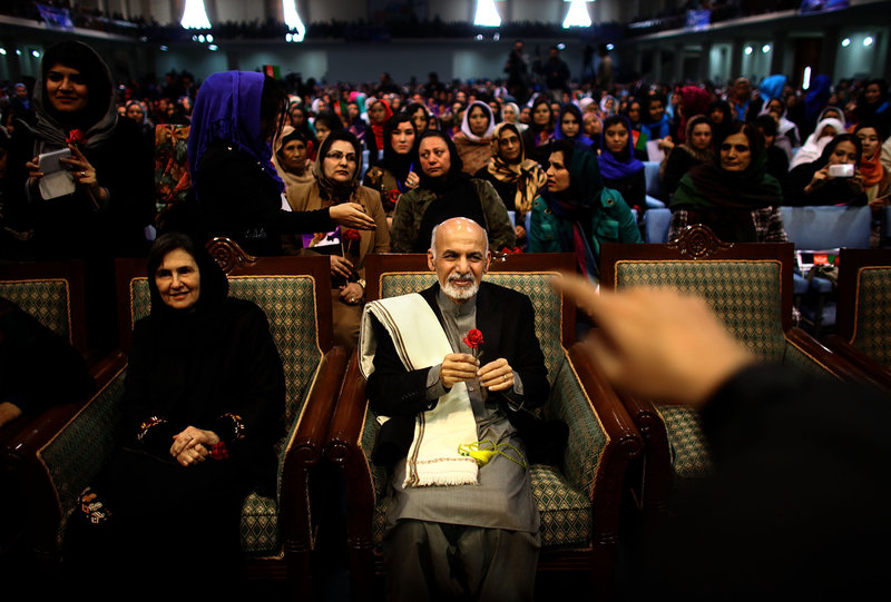 Then-presidential candidate Ashraf Ghani sits next to his wife, Rula, during a campaign rally in Kabul on March 9, 2014. In an unusual move for Afghan politics, Ghani's wife spoke during the rally — a foreshadowing of her role in her husband's presidency. David Gilkey/NPR