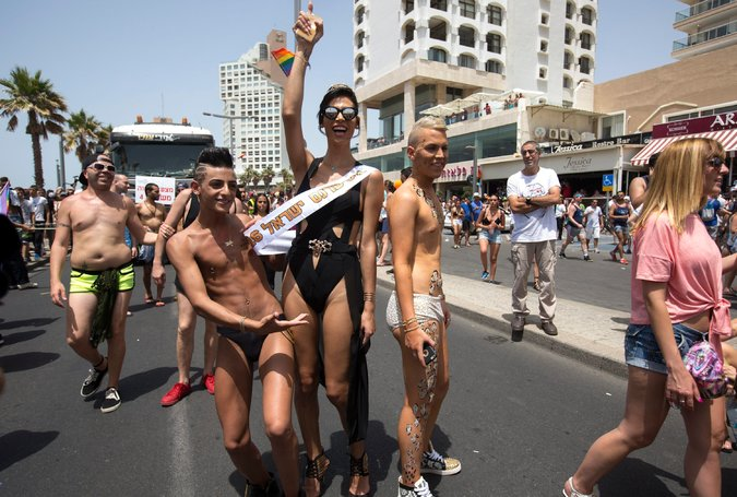 "Ms. Abu Hanna, center, at Tel Aviv's Gay Pride Parade in June. ""I'm Arab. I'm Christian. I'm Israeli,"" she said. ""All that is tied together."" Credit Jim Hollander/European Pressphoto Agency"
