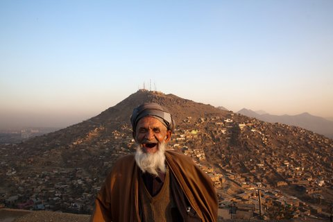 Eid Muhammad, 70, lived in a house with a view overlooking the hills of Kabul.