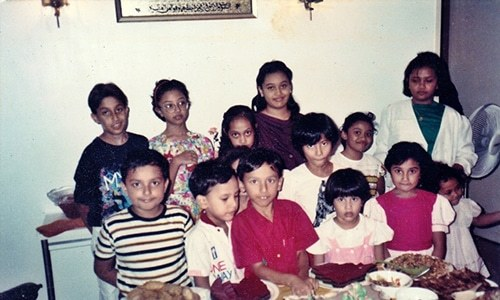 Third and fourth generation Singaporean-Pakistani children celebrating a birthday. This photo was taken in the early 1990's. Photo credit: Author Provided