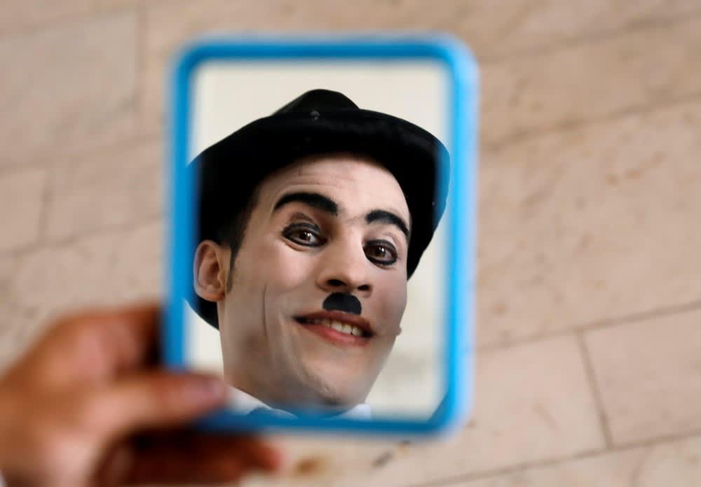 Karim Asir, Afghanistan's 'Charlie Chaplin' Braves Bombs To Bring Smiles
