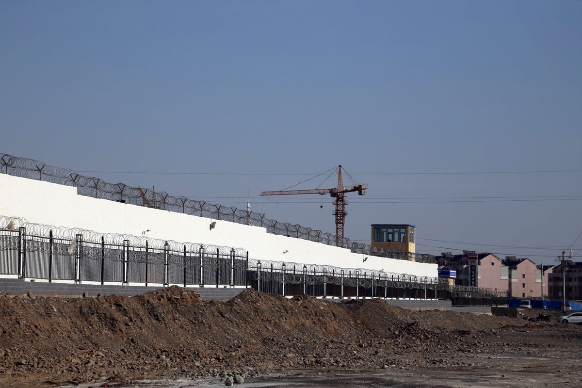 High walls and razor wire surround a facility in the city of Turpan in China's Xinjiang region that Western researchers say is a political indoctrination centre for Muslim Uyghurs.