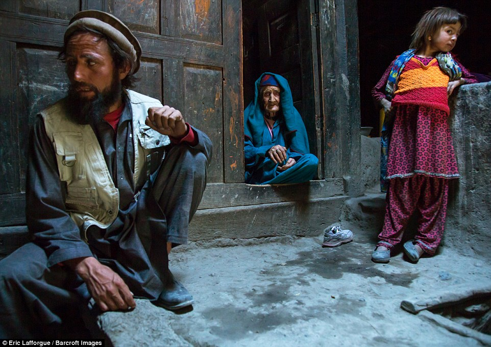 fghan man with his old mother and his daughter in a Pamiri house. People have lived in the mountains here for 2,000 years