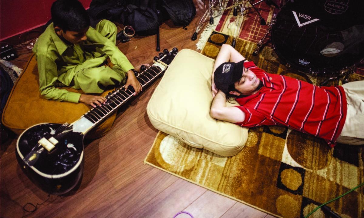 Sounds of Kolachi's Faraz Anwar takes a break during rehearsals at the Elektric Room, a studio run by Bilal Brohi  Mohammad Ali, White Star
