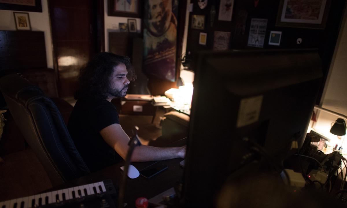 Zohaib Kazi at his home studio I Mohammad Ali, white Star