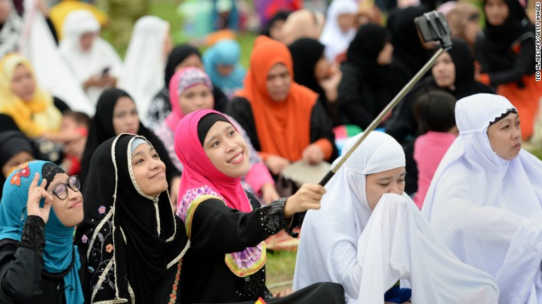"Young Muslims devotees take a ""selfie"" prior to Friday prayers to mark the end of Ramadan in Manila last year."