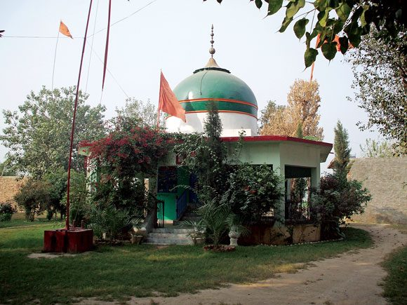 Located in a village on the outskirts of Lahore, the shrine of Sher Shah is decorated with orange flags, which are symbols of Sufism.