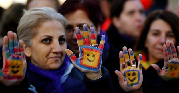 Protesters show their painted hands during a protest against a proposal that would have allowed sentencing in cases of sexual abuse committed \