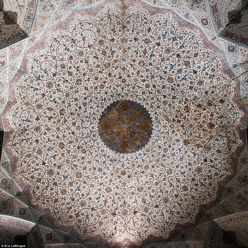 This ceiling in Ali Qapu, a grand palace in Isfahan, has been restored and repaired by Iranian and Italian artists and masters