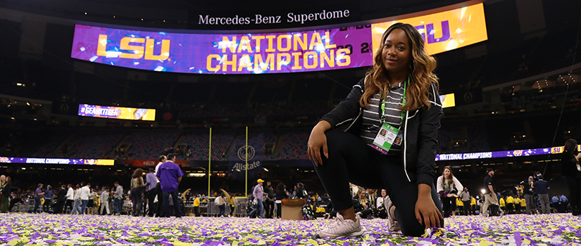 Photo of Nya Green posed in front of a LSU National Champions banner