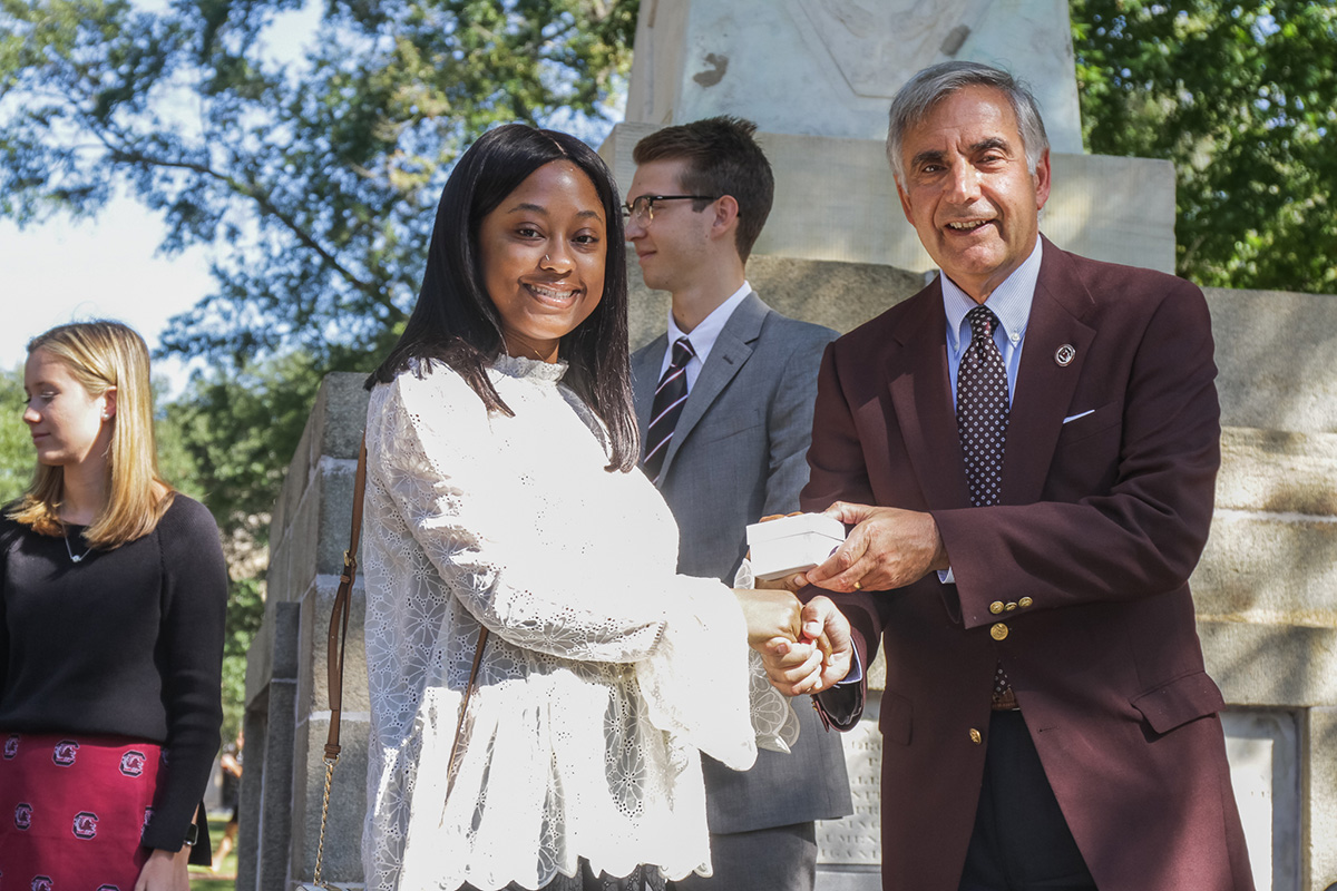 Photo of Dr. Pastides handing out the official Carolina ring at the 2018 ring ceremony