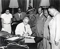 President Truman establishes Freedom Day surrounded by civil rights leaders.
