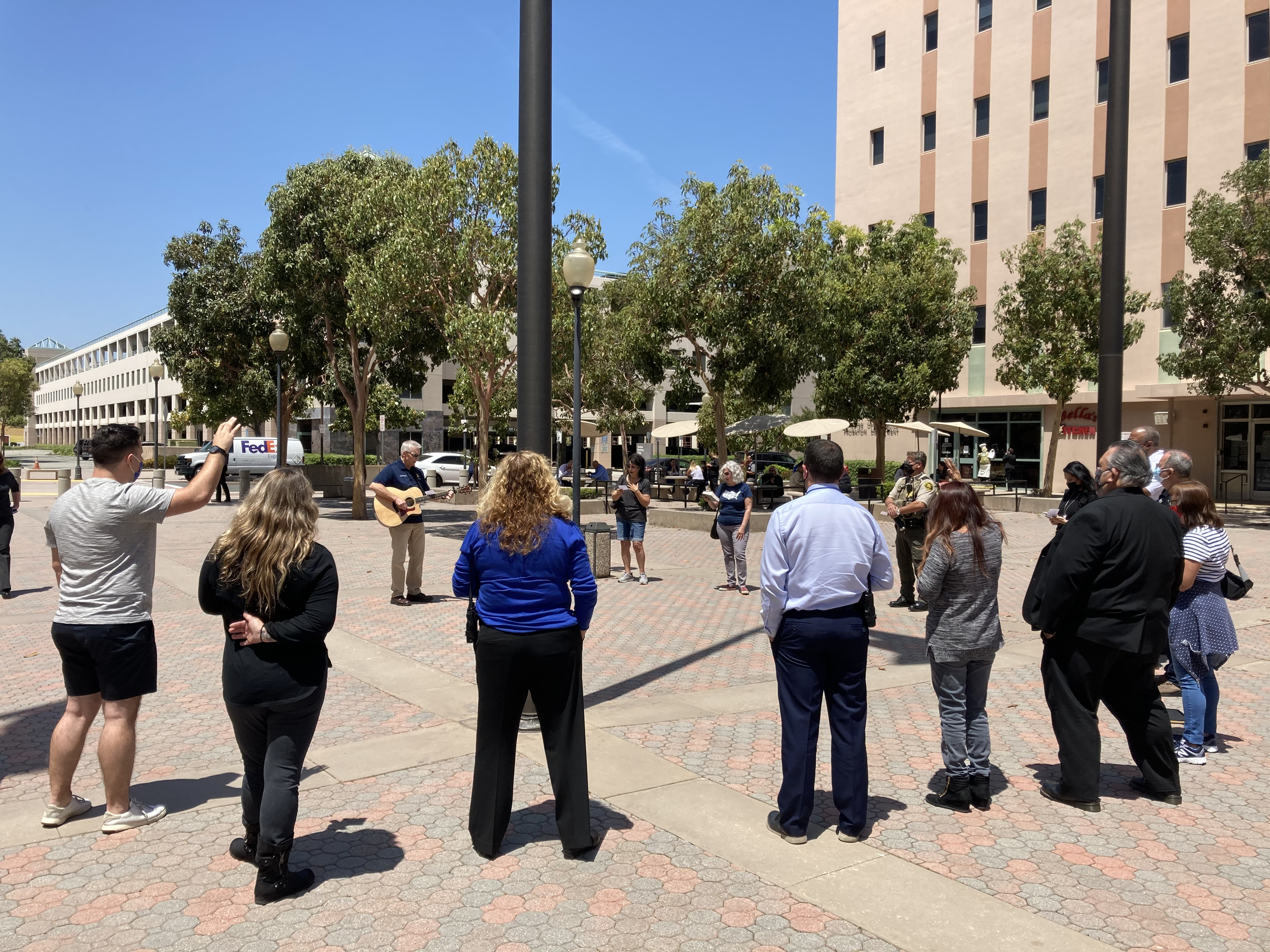 NDP attendees sing a worship song together outside of a Juvenile Justice Center in Santa Ana, California.