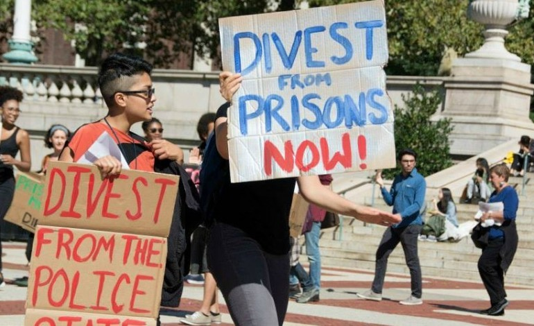 DivestfromPrisons.jpeg