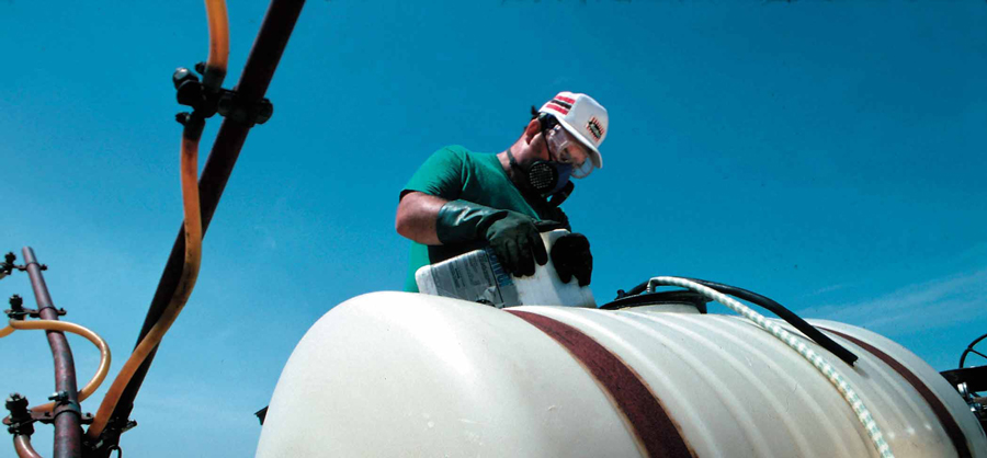 Working with PPE filling tank with chemical