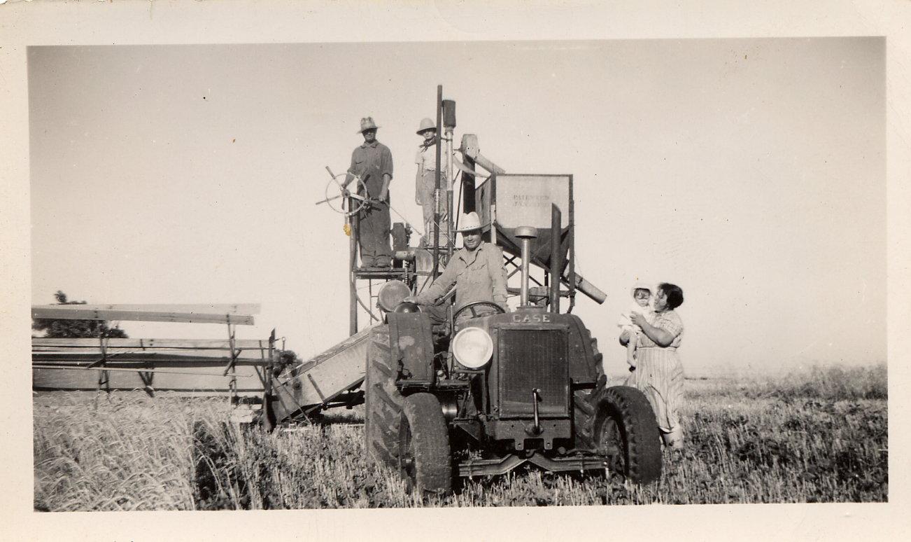 Christina's great grandparents in an Oklahoma farm field, thrashing wheat