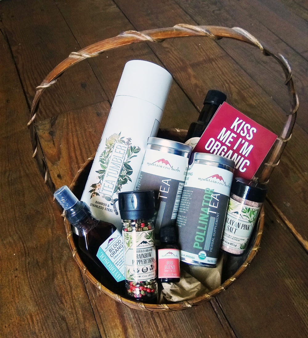 Gift basket with organic teas, essential oil and more