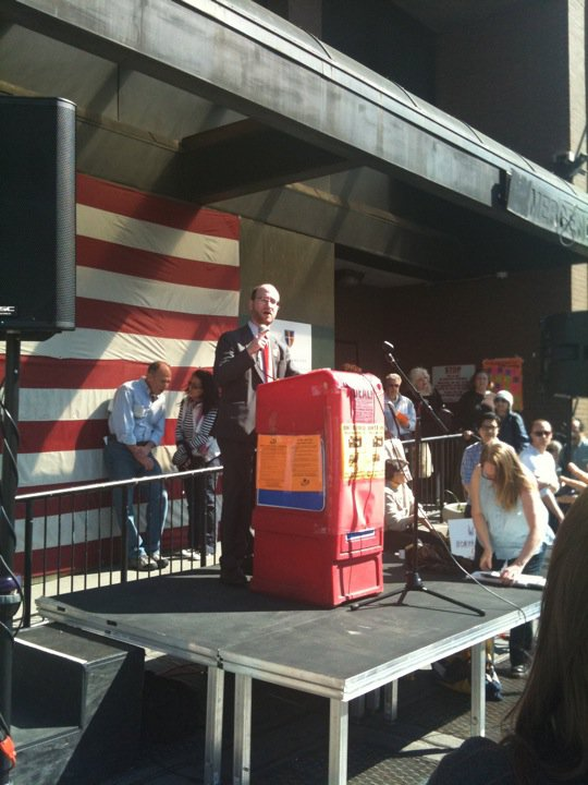 Newell speaking at a Coalition for a New Village Hospital Rally