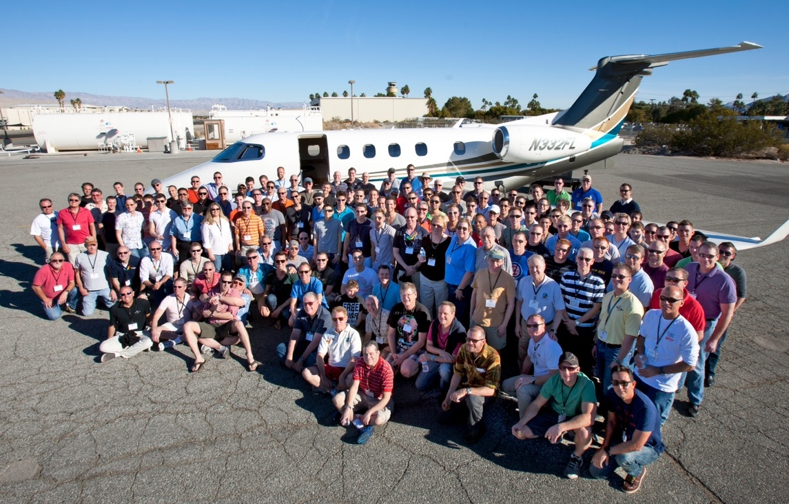large_group_in_front_of_plane_331900855.jpg