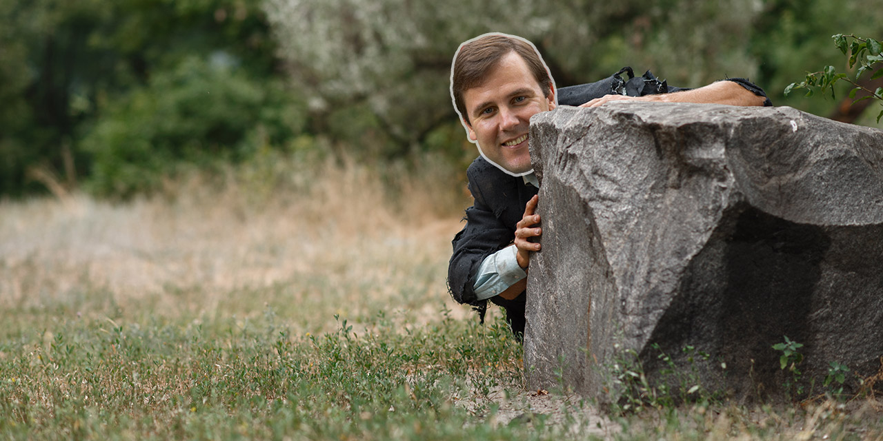 Tom Kean, Jr hiding behind a rock