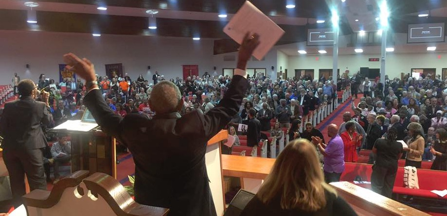 NOAH_-_Crowd_and_Rev_Thompson_from_behind_-_Public_Meeting_-_Oct_29_2017.jpg