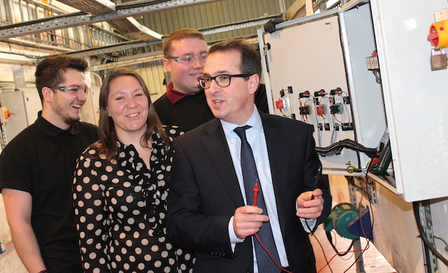 Anna Turley and Owen Smith with two former SSI apprentices at TTE training
