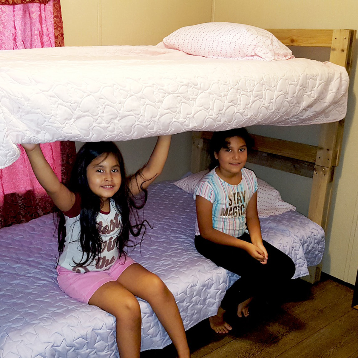 Family Receives New Bed from NAM & SHP