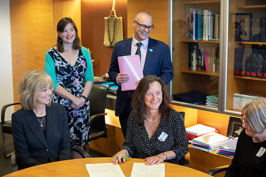 Health Minister Dr David Clark and Associate Health Minister Julie Anne Genter join midwives to sign an accord for safer staffing.