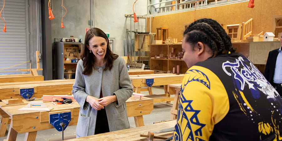 Jacinda Ardern meets with a student at WelTec construction school