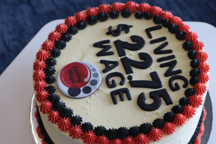 Cake with new Living Wage rate written with icing
