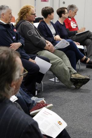 workshop participants sit