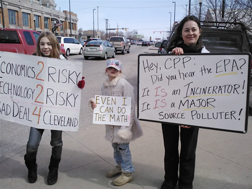 Ann Knotek and her daughters protest the proposed Cleveland garbage incinerator in 2013.
