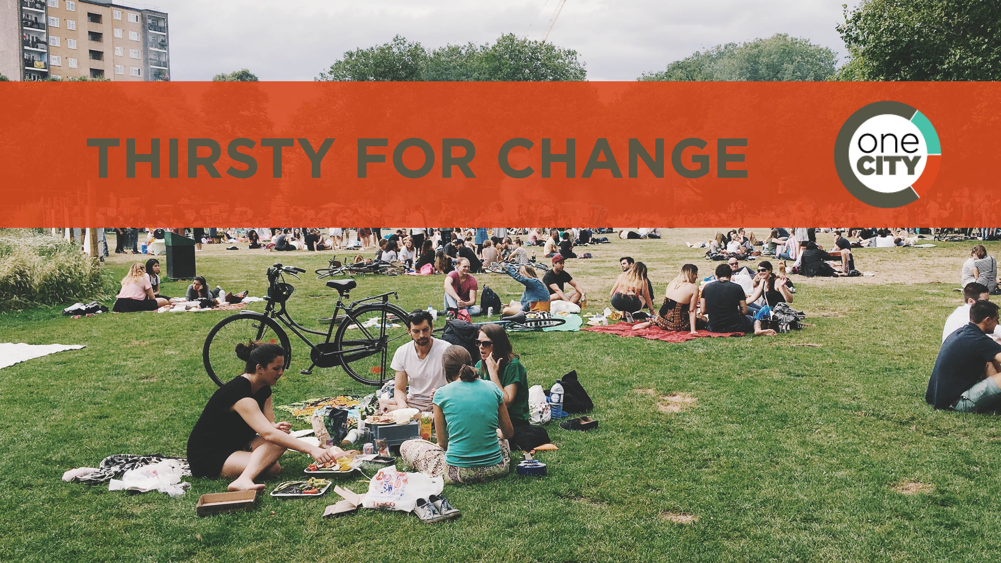 Groups of people sitting in a public park with thirsty for change written as text