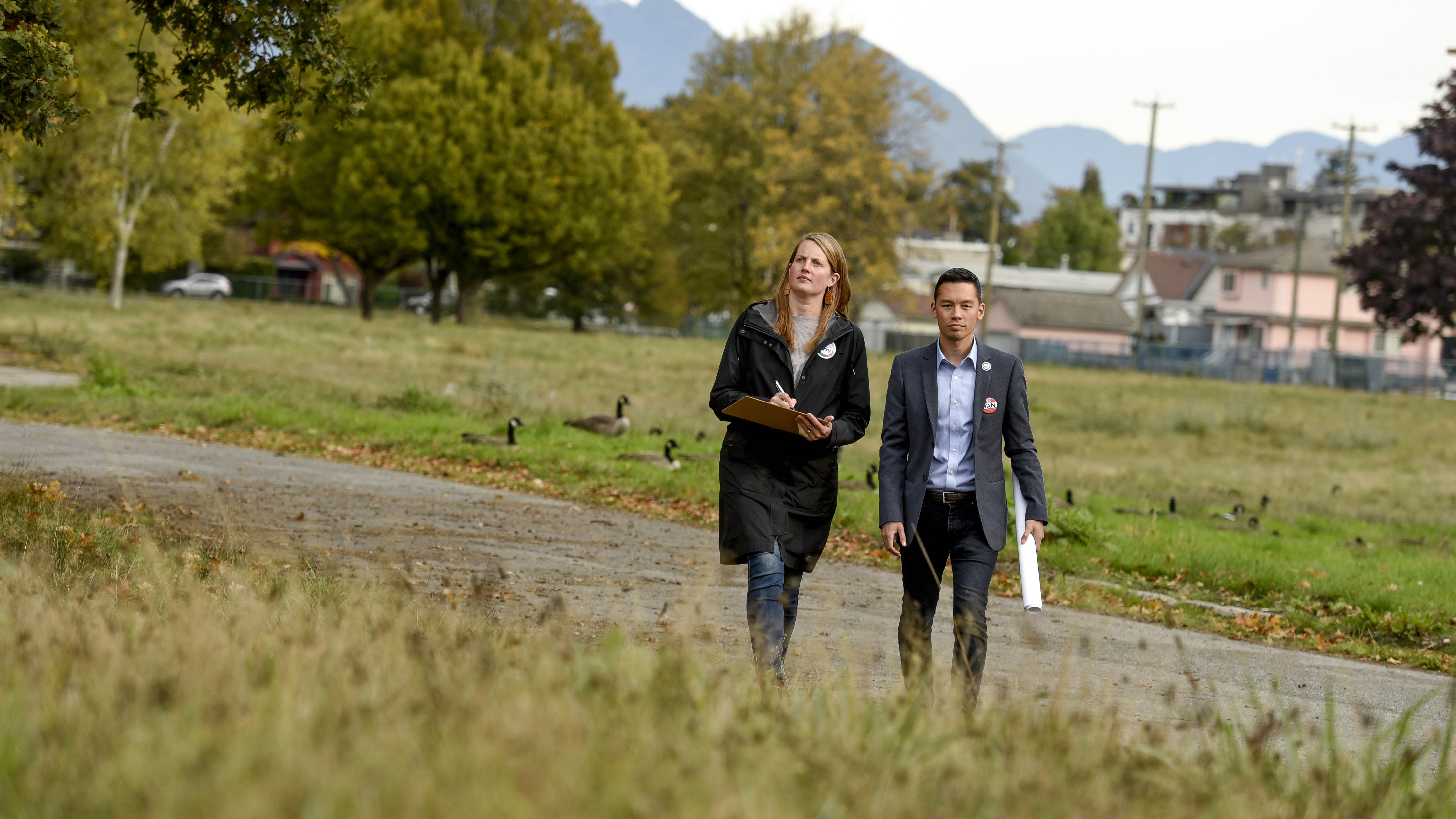 Christine Boyle and Brandon Yan walk through former site of Little Mountain Housing