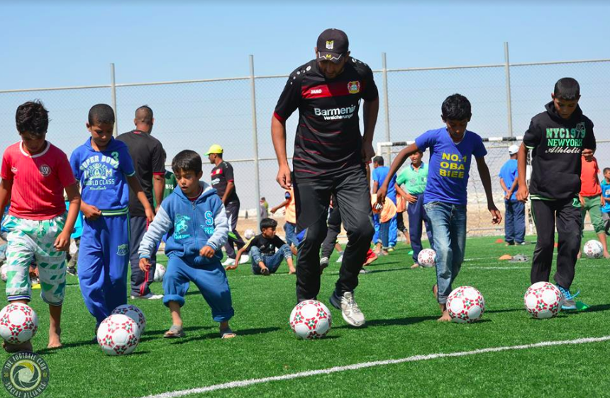 Syrian refugee coaches train for grassroots football activities for children