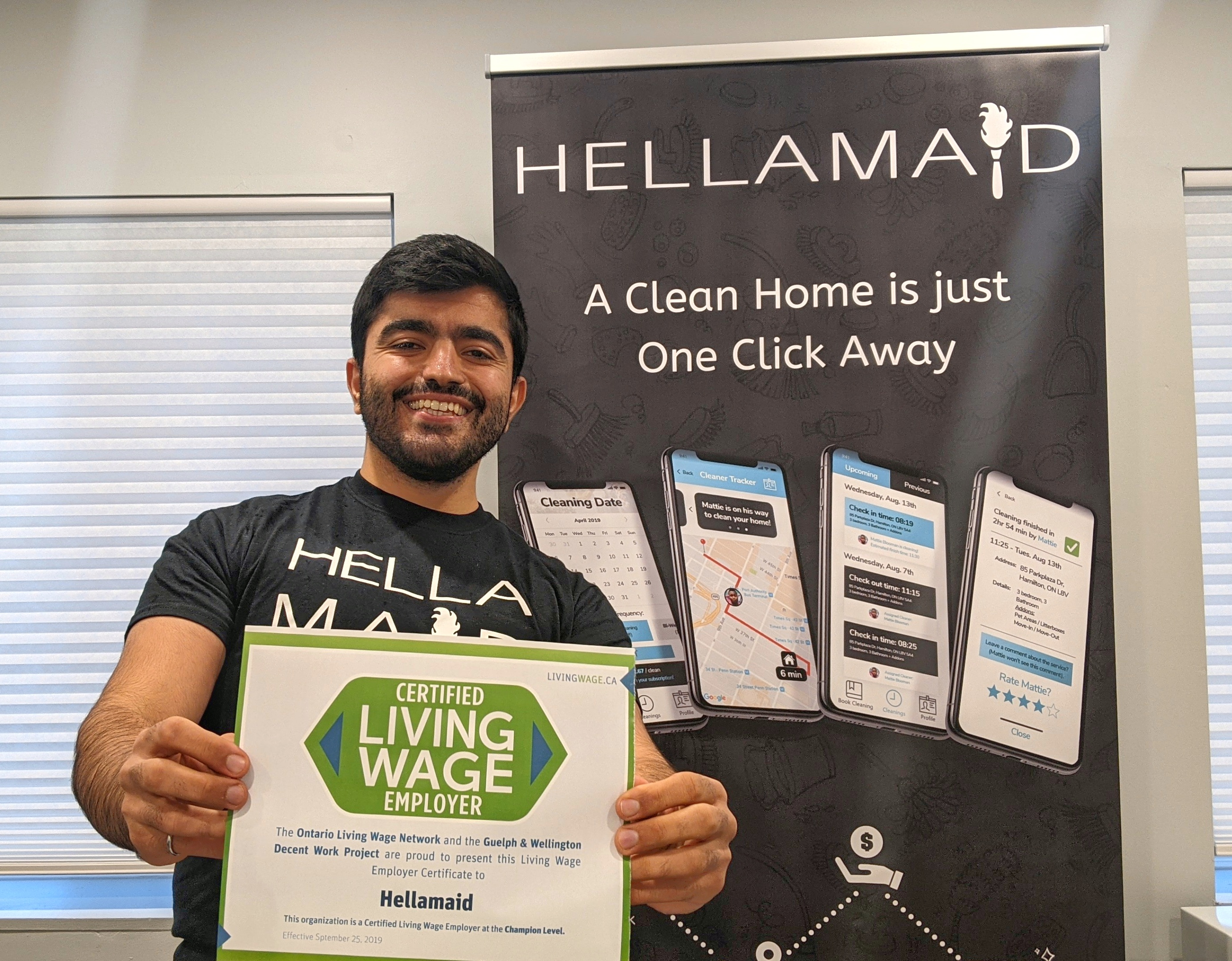 Ahmed Mezil, owner of Hellamaid with his Living Wage Employer Certificate