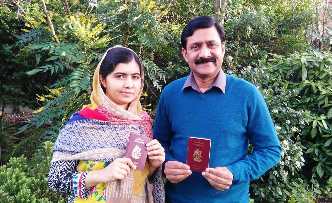 Malala Yousafzai and her father with their passports