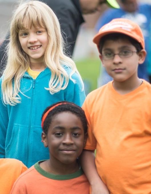 Three_kids_at_field_day.jpg