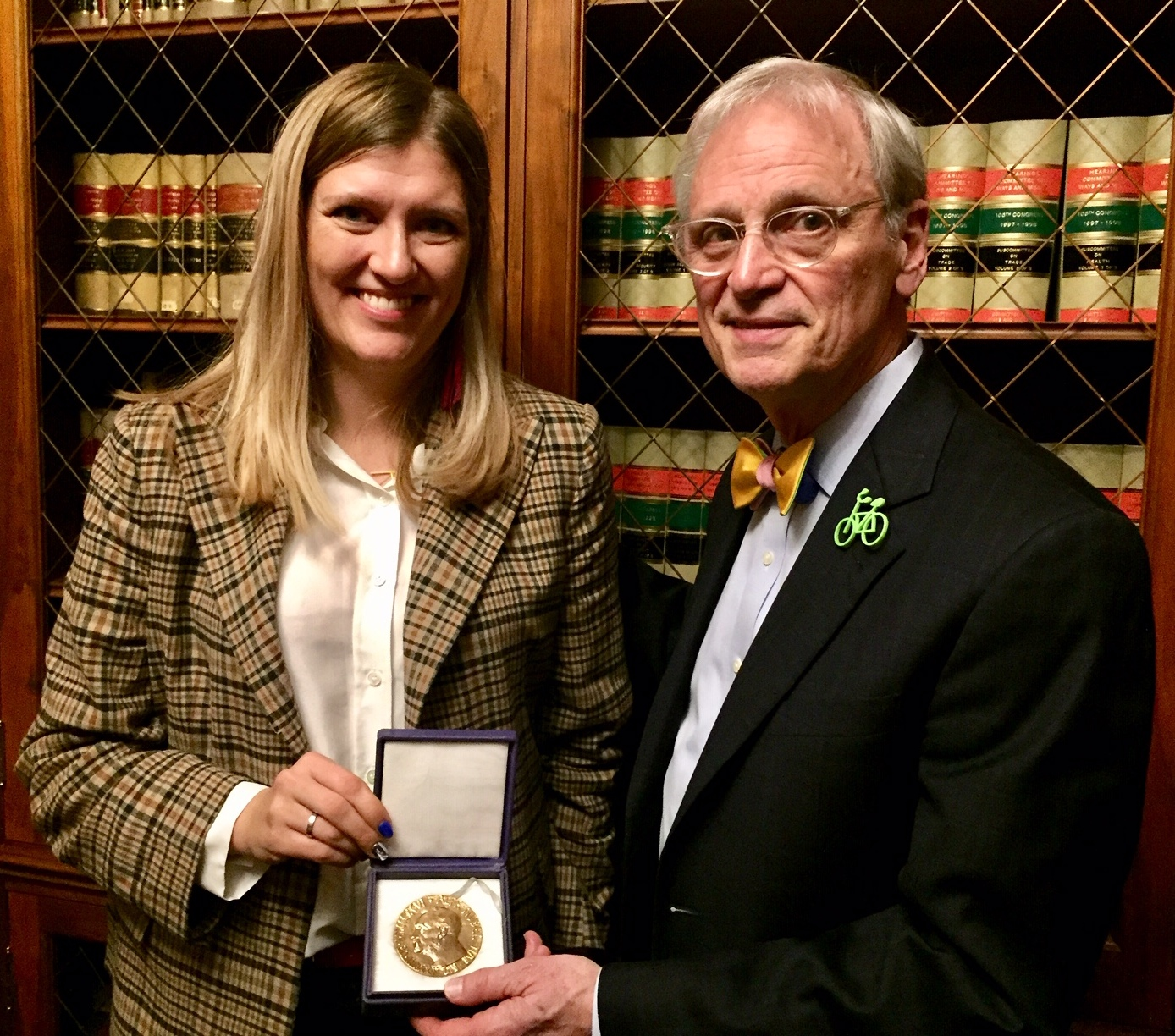 Earl_Blumenauer_and_Beatrice_Finn_with_Nobel_Peace_Prize.jpg