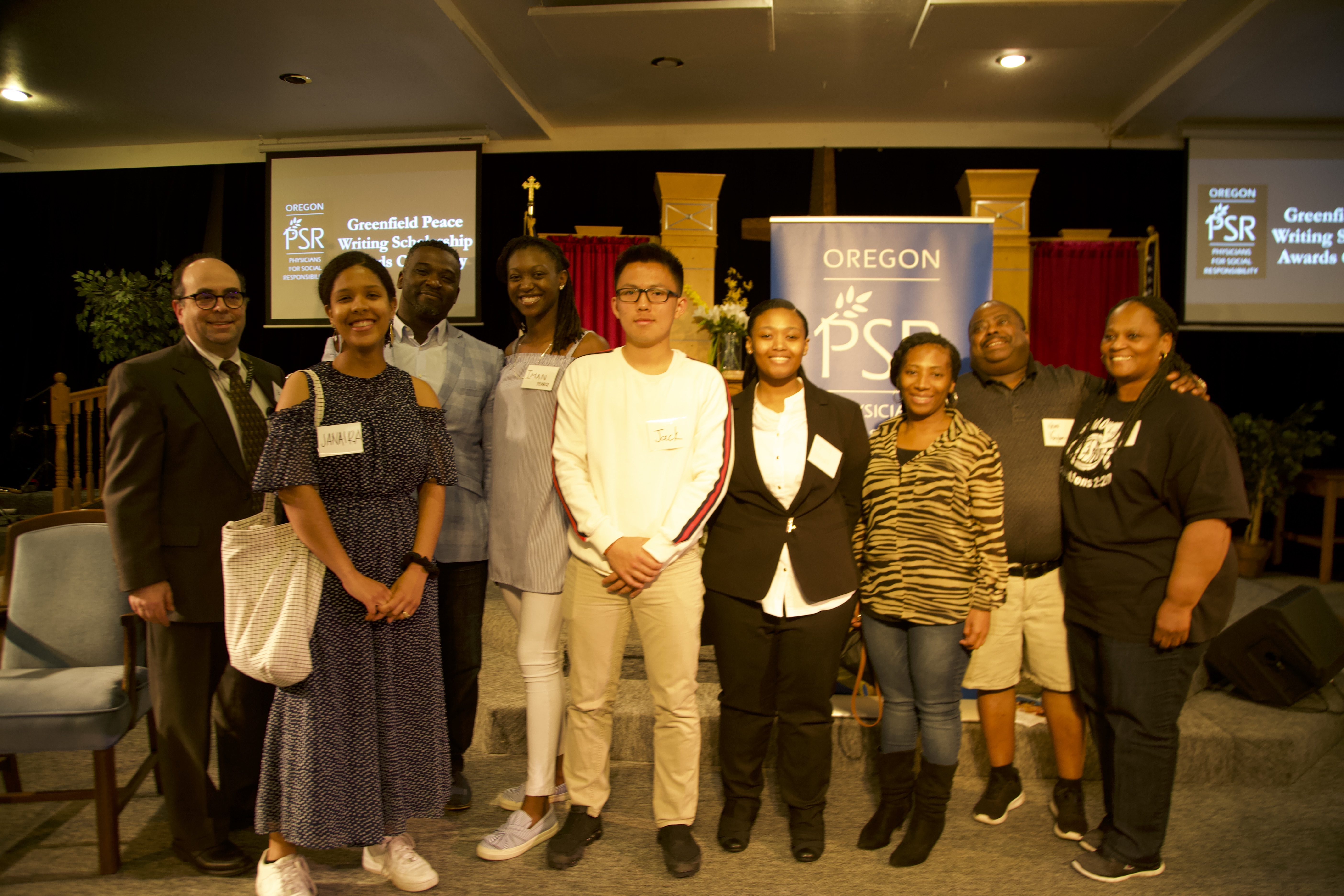 scholarship winners with their families and two of the judges at the awards ceremony