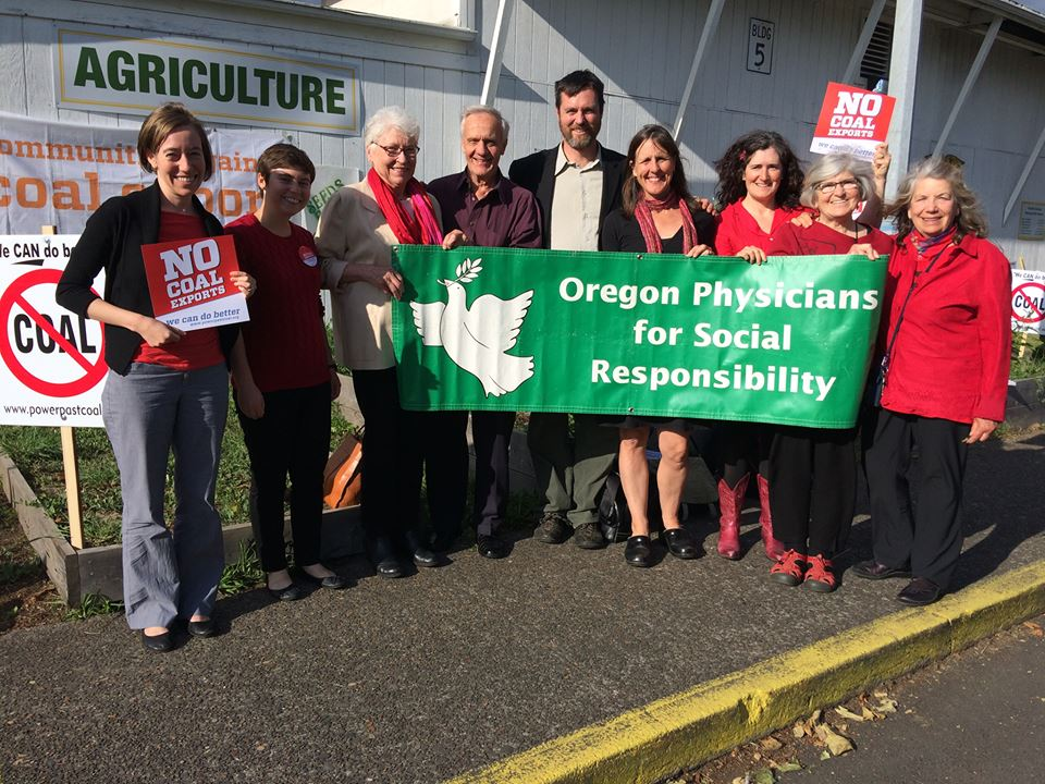 Oregon PSR staff, members at a rally for no coal exports