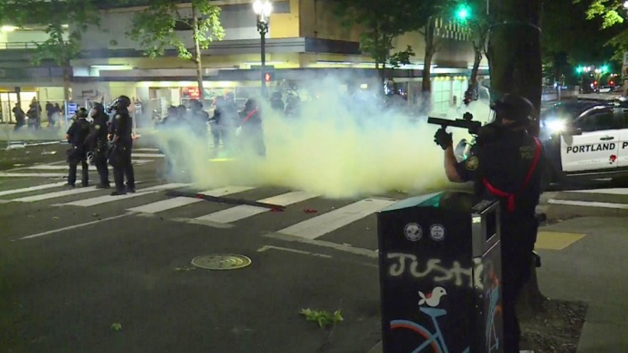 Portland_police_tear-gassing_peaceful_protesters_(from_KOIN-6).jpg