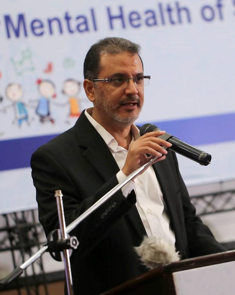 Photo of Dr. Yasser Abu Jamei speaking