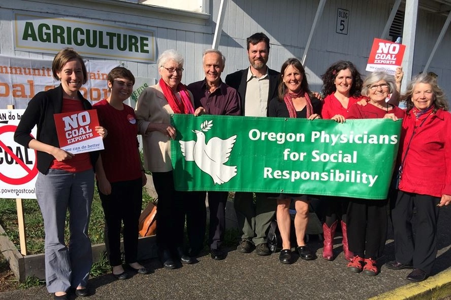Oregon PSR staff and members holding signs at an anti- coal exports rally at Longview