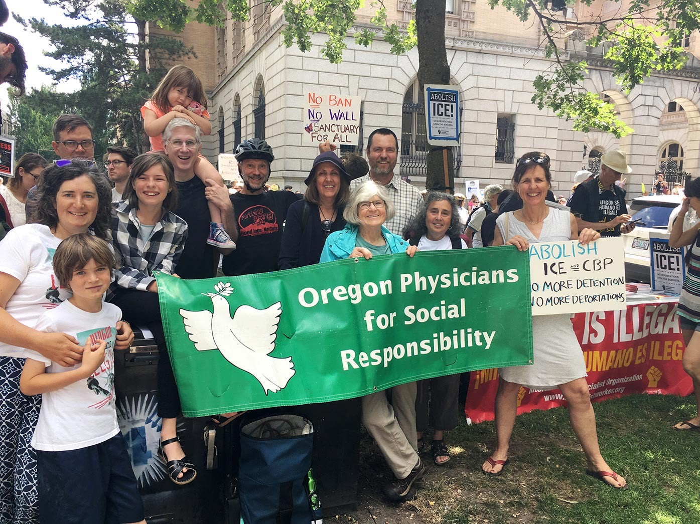 Oregon PSR members at a rally holding signs